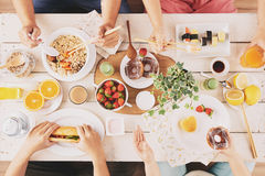 Lunch. People having Asian food, sandwiches and donuts for lunch stock photography