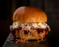 Close up of a single pulled pork sandwich with Cole slaw Stock Photography