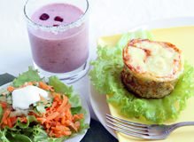 Lunch with salad and tuna casserole. Lunch with salad and tuna vegetable  casserole Stock Images
