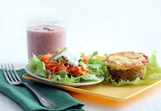 Lunch with salad and tuna casserole. Lunch with salad and tuna vegetable  casserole Royalty Free Stock Photography