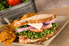 Lunch Sandwich With Ham Turkey Swiss Cheese And Chips Stock Photos