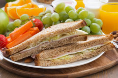 Lunch with sandwiches, drinks and fresh fruit Royalty Free Stock Images