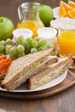 Lunch with sandwiches, drinks and fresh fruit, vertical Stock Photography