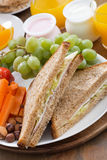 Lunch with sandwiches, drinks and fruit, vertical, close-up Stock Photography