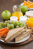 Lunch with sandwiches, drinks and fruit, vertical Royalty Free Stock Images