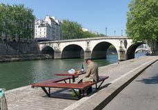 Lunch on Seine river quay royalty free stock photography