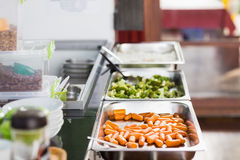 Lunch service station in school cafeteria. Fresh meal in lunch service station at school cafeteria Royalty Free Stock Image