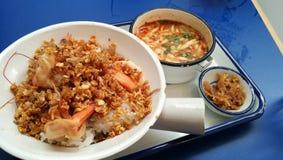 Lunch set - Stir fry garlic pepper prawn and mushroom tomyum soup Stock Photo