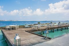 Lunch setup with tables and chairs at the tropical beach. In Maldives Royalty Free Stock Image