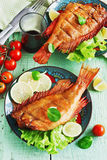 Lunch of smoked sea bass Stock Image