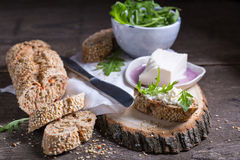 Lunch. Some healthy rye bread with cream cheese and arugula Stock Photos
