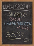 Lunch special menu sign. Jalapeno, bacon, cheese burger, fries - lunch special menu - vertical blackboard sign with color chalk handwriting Stock Photos