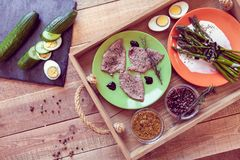 Lunch with steaks and asparagus on a tray Royalty Free Stock Photo