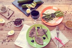 Lunch with steaks, asparagus and wine Royalty Free Stock Photos