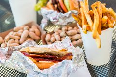 Lunch. Street food lunch with peanuts, hotdog, and hamburger Stock Photos