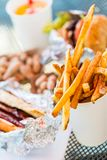 Lunch. Street food lunch with peanuts, hotdog, and hamburger Stock Photography