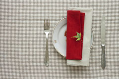 Lunch table appointments. With plate, knife and fork on linen tablecloth Stock Photography