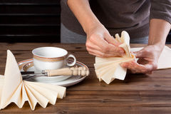 Lunch table napkin folding Stock Photo