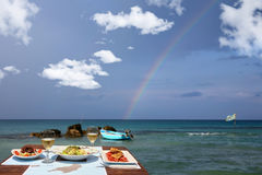 Lunch table for two by the sea Royalty Free Stock Photos