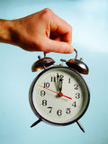 Lunch Time. A hand holding an alarm clock Stock Images