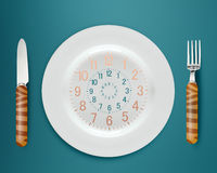 Lunch time. Concept, clock in plate, knife and fork Royalty Free Stock Photography
