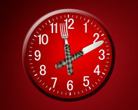 Lunch time. Concept, clock in plate, knife and fork Stock Photo