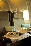 Lunch time. Lunch on board of a luxury aircraft Royalty Free Stock Image