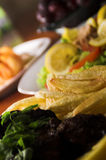 Lunch time. A variety of food including salad, fried potatoes, etc Royalty Free Stock Photos