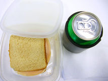 Lunch Time!. A can of soda and a sandwich in a container stock photo