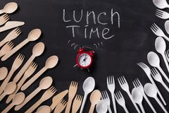 Lunch time written on blackboard with chalk Royalty Free Stock Image