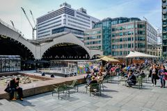 Lunch time at Exchange Square, London, with office workers. Stock Photo