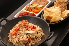 Lunch time - fried rice served in the restaurant. Lunch time - fried rice served in restaurant Royalty Free Stock Images
