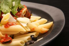 Penne pasta in tomato sauce. Lunch time - Penne pasta in tomato sauce Stock Images