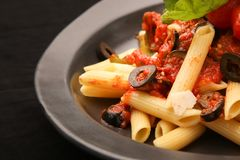 Penne pasta in tomato sauce. Lunch time - Penne pasta in tomato sauce Stock Image