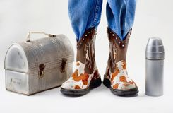 Lunch Time for School. Lunch box for school with young boy in cowboy boots stock images
