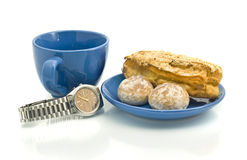 Lunch time - Watch, blue cup, pastry. Waiting for Lunch time - Watch, empty blue cup and delicious pastry Stock Photo
