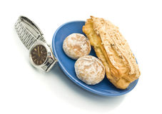 Lunch time - Watch and delicious pastry Royalty Free Stock Photos