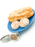 Lunch time - Watch and delicious pastry. On white Royalty Free Stock Photos