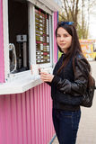 Lunch time. Young woman buying coffee Royalty Free Stock Photo
