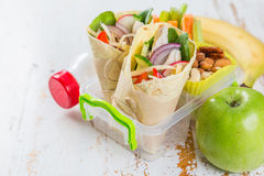 Lunch to go with tortilla wraps and vegetables Royalty Free Stock Image