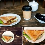 Lunch with triangle sandwich, takeaway coffee and sunglasses on old wooden table Royalty Free Stock Photos