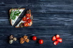 Lunch with triangle sandwiches on dark table background top view mockup Stock Photo