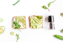 Lunch with triangle sandwiches on white table background top view Stock Photos