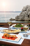 Lunch for two by the sea Stock Photography