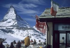 Lunch with a view of the Matterhorn. Skiers, Riffelalp, ZermattSwitzerland Stock Image