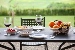 Lunch With A View - Table Against Beautiful Landscape In Tuscany Stock Images