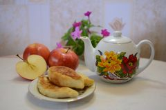 Tea time. Yummy patty with apples. Vegetarian food Stock Image