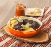 Lunch z ringowymi pudding kiełbasami, grulami i obrazy royalty free