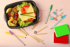 Lunchbox with dinner and stationery Stock Photos