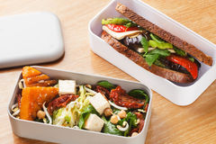 Lunchbox salad with pumpkin chickpeas and a sandwich with grille stock photos
